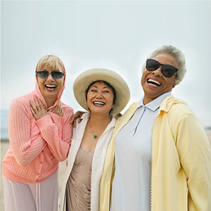 3 mature woman at the beach